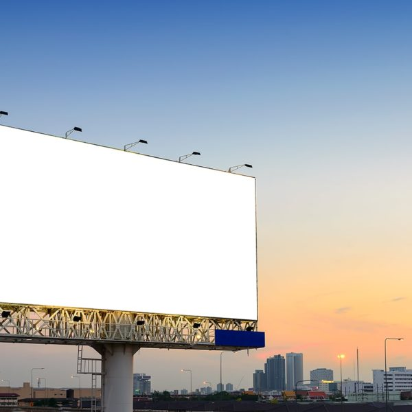 Billboard at sunset lit with LED lighting