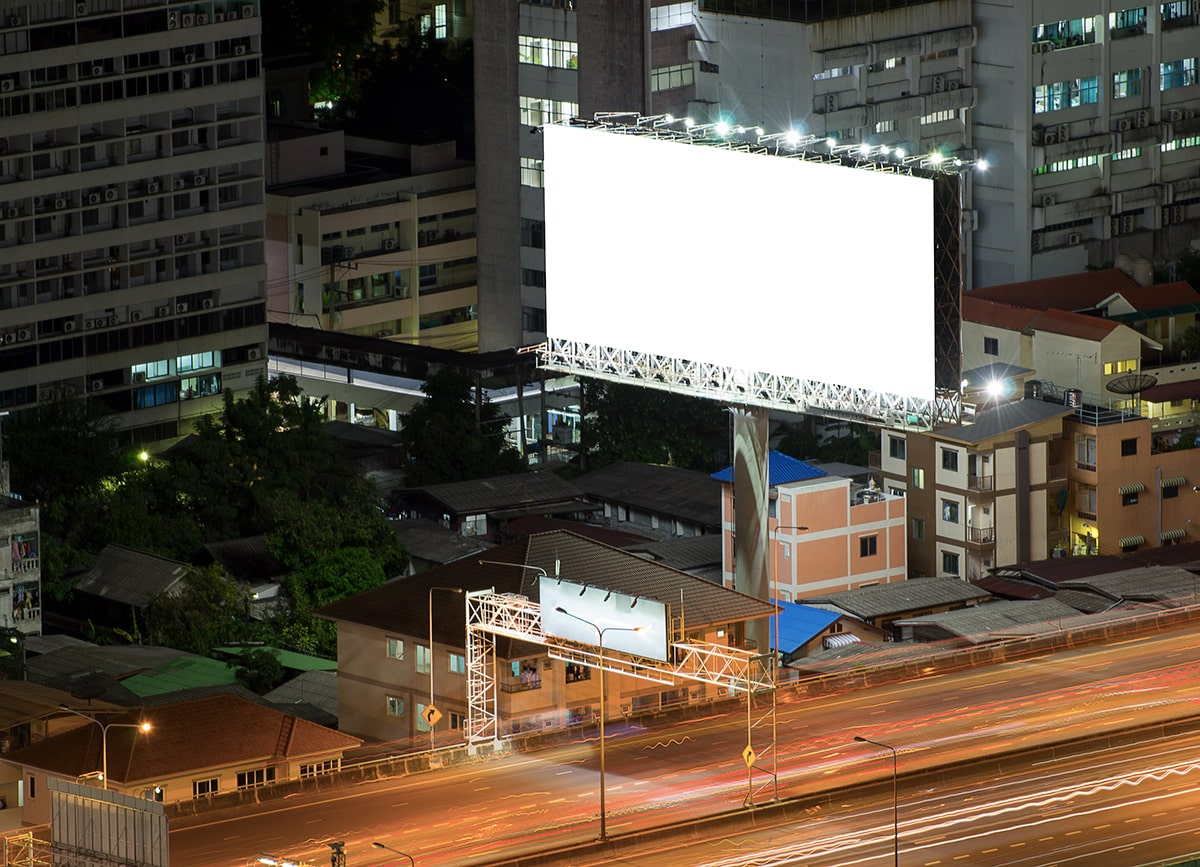 Billboard at night over highway